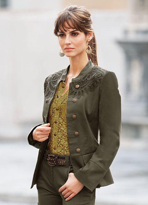 Ariadne Artiles - Moss green military style jacket & matching slacks, studded belt, dangle earrings, paired w/ ecru lace button down blouse. The two shades work well together!