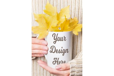 Mockup - White cup with fall maple leaves in female hands (934348) | Seasonal | Design Bundles