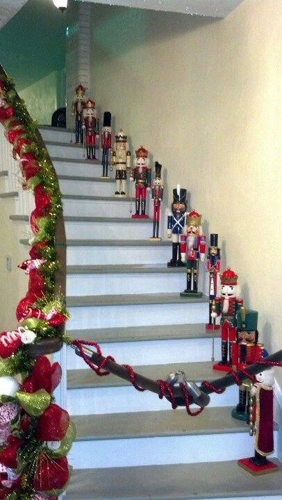 Decorate your staircase with nutcrackers and red & green tutu wrap around railing.