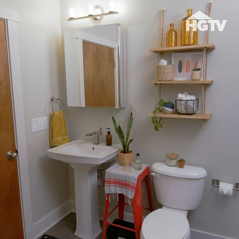 Make big changes for your small bathroom with a few creative storage solutions. 🧼 🧻 Explore 30+ small bathroom designs when you click through. Sponsored by Signature Hardware.