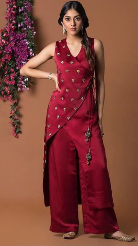 Beautiful satin-Silk Angrakha style kurti with brilliant detailing and embellishments with hand embroidery work. Paired with Plazo Pant.