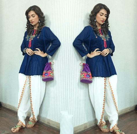 White Tulip Pants and Blue Shirt Outfit in Ayeza Khan with Traditional Style Jewellery and Pouch on the set of