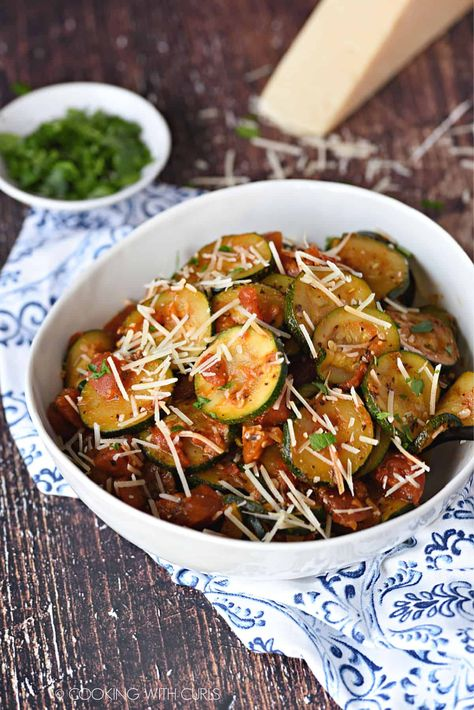 Sautéed Zucchini and Tomatoes cooked with garlic and Italian seasoning, topped with Parmesan Cheese is an easy and delicious side dish! #sidedish #zucchini #Italiansidedish #skilletzucchini