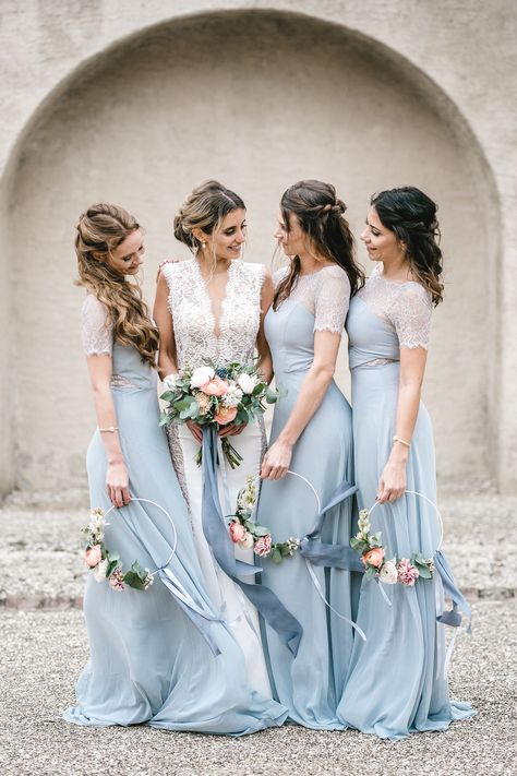 These are the best hoop wedding bouquets. We're loving this unique wedding bouquet trend.