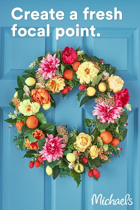 This vibrant floral and fruit wreath is the perfect update to the summer season. The realistic feeling, tones and shapes of the flowers and fruit will be admired by all!