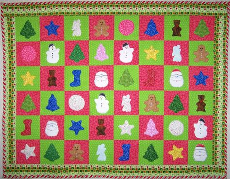 Celebrate National Cookie Day as well as the holiday season with this cookie cutter Christmas quilt.