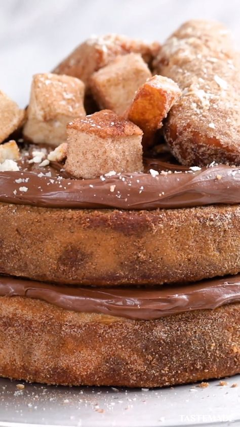 What's better than fresh churros dipped in molten hot chocolate? Nothing, really. But this churro cake filled with layers and layers of Nutella is a close second.