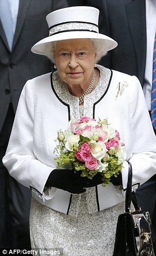 Arrival: For her arrival in Paris, the Queen chose a metallic cream dress and matching jacket