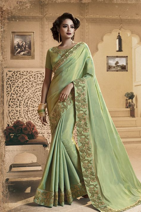 Designer Light Green Colored Saree Paired With Light Green Colored Blouse