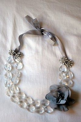 DIY - Fold a necklace in half.  Attach ribbon to both ends. Add clip earrings to hide the ribbon knots.  Add flower pin if desired. Love this idea