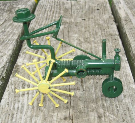 John Deere Wanna Be Nails Nut and Bolt Figure on Tractor via Etsy