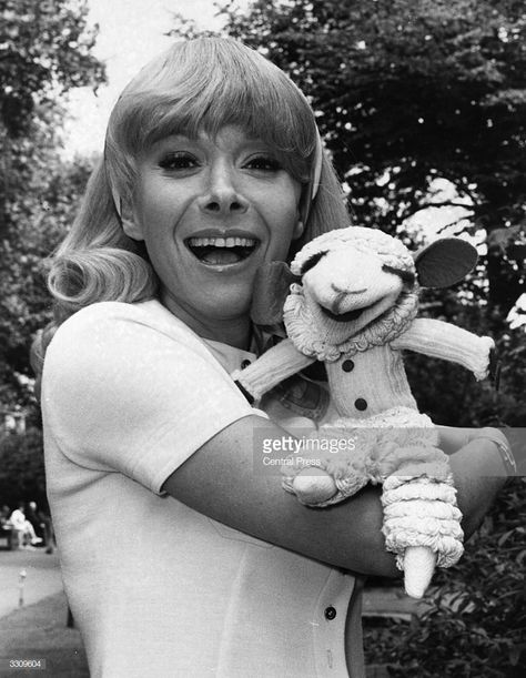 Television personality Shari Lewis shows off her famous puppet 'Lamb Chop' outside the Savoy Hotel. She has just arrived in London to appear in cabaret at the Savoy and a BBC Television show.