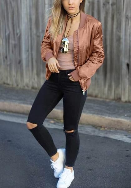 Full front view of model in rose gold satin bomber jacket