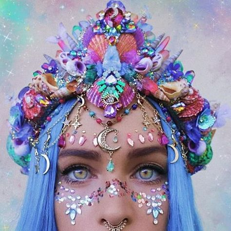 Its like a rainbow, crystal garden an galaxy all got made into the convenience of a single crown. Its hard to see on a photo but this crown has so many crystals and raw crystal rocks!
