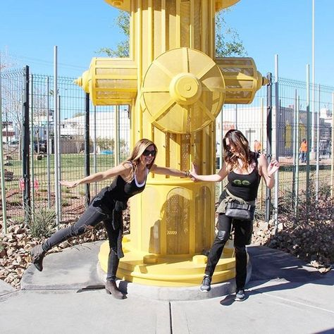 A while back we saw this giant hydrant! I think #GOLIATHGirls @Amie_Yancey and @Rexalynn didn't quite know how you are supposed to pose with a giant hydrant.  Good effort! #GoliathCompany #FireDepartment