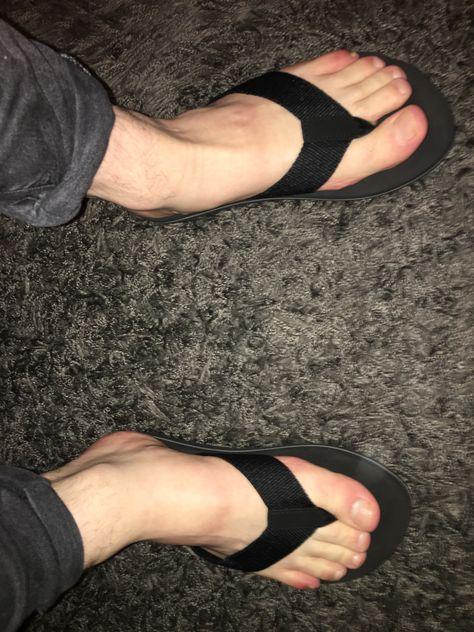 my Feet in Black Flip Flops
