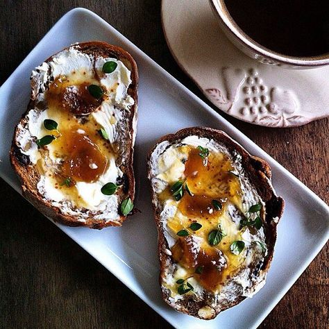 "Love these ingredients! ""Soft tangy lemon #chèvre, sweet #fig jam and garden fresh #thyme on #walnut #rye :: #breakfast by the window and enjoying what is left of the crisp #morning air before what looks like a thunderstorm of the century (wouldn't mind the window wash though). Happy #Weekend!"" http://evpo.st/1rKzIiX @beurrenoisette_ #feedfeed http://www.feedfeed.info"
