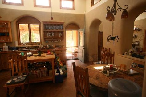 Cob House Kitchen....love the rounded, deep window casings, the height, and the windows...