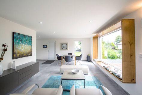 ICON Wohnbeispiel : Moderne Wohnzimmer von Dennert Massivhaus GmbH