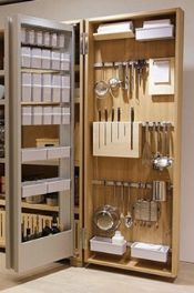 A well organized cabinet from Bulthaup makes use of height to gain extreme  storage space in