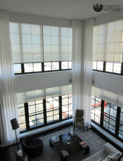 Free yourself from the mess of cords and the bother of blind rods. Motorized blinds and drapes make managing natural light easy   modern curtains by NY Window Fashion Inc.