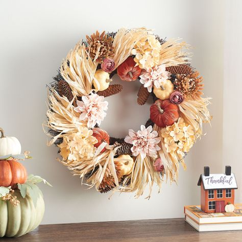"""Way to Celebrate Pumpkin and Blossom Harvest Wreath, 24"""" - Walmart Finds - This wreath gives your seasonal decorating a stunning new look. Durably constructed, this gorgeous wreath is designed in warm shades of the season for a long life of reliable use year after year. The hanging wreath features miniature pumpkins, leaves, and other harvest elements for a unique look. #walmarthome #walmartfinds #fallwreath #falldecor #falldecorideas"""