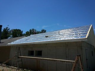 Reroofing With Corrugated Metal And Radiant Barrier Over Asphalt Shingles In 3 Steps In 2020 Reroofing Metal Roof Over Shingles Metal Roof Installation