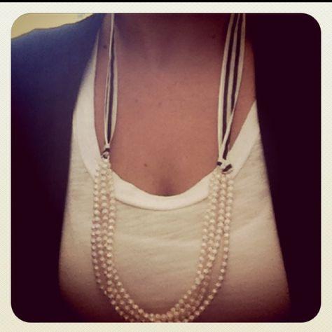 Fold a necklace in half & attach a ribbon. Love!!