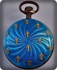 blue pocket watch with gold fleur de lis's.