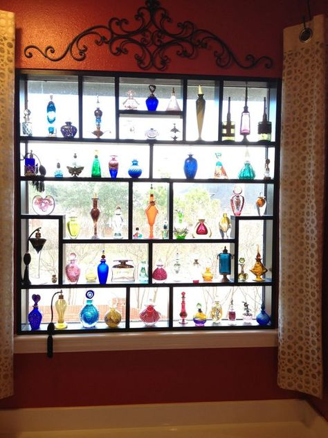 The Window Was Filled With Pieces Of Colored Glass Tiny Transparent Bottles In Delicate Colors With Images Colored Glass Bottles Glass Display Shelves Glassware Display