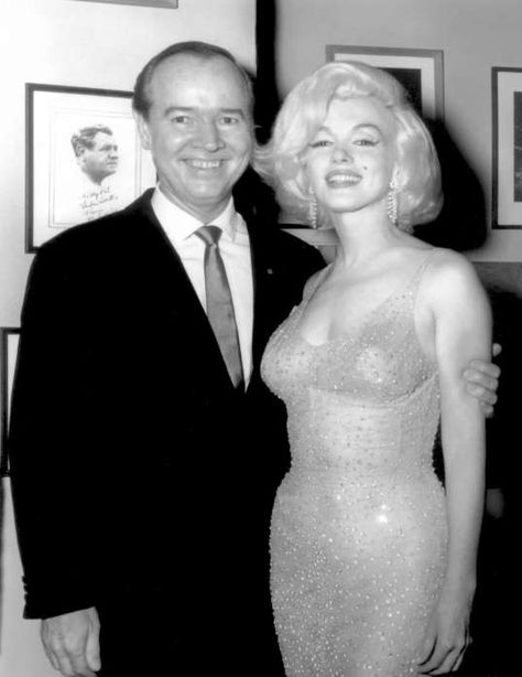 May 1962 Marilyn Monroe and celebrity promoter Earl Blackwell pose for a photo at the birthday gala for President John F. Kennedy, where she sang