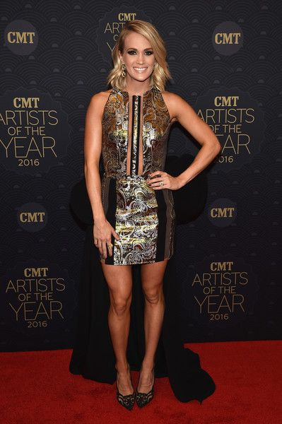 Honoree Carrie Underwood arrives on the red carpet at CMT Artists of the Year 2016.