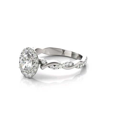 Forever One colorless D-F moissanite center with genuine diamond side stones.