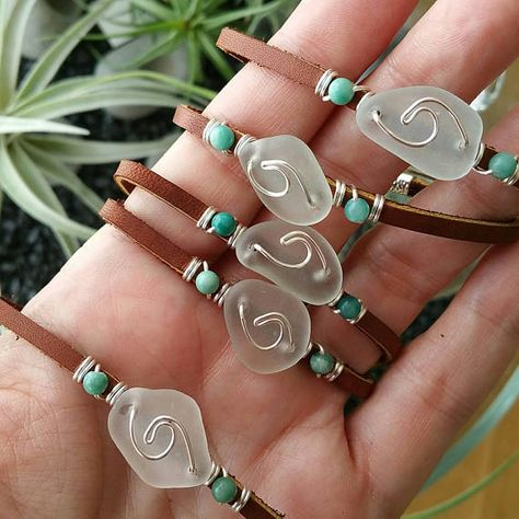 Each wave is a little unique, just like you! These leather bracelets have been hand-crafted with a little wave in silver-plated wire on genuine sea glass in the color of soft white or pale sea foam sea glass, and two Brazilian Jasper stones wire-wrapped on genuine leather. Choose