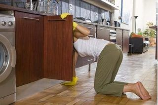 How To Stain Laminate Furniture Hunker Clean Kitchen Cabinets Laminate Furniture Laminate Kitchen Cabinets
