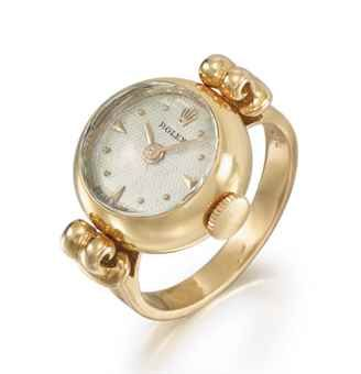 Rolex. An 18K Gold Ring Watch circa 1950. Sold by Christies at auction. Estimated $ 5,000 - 8,000