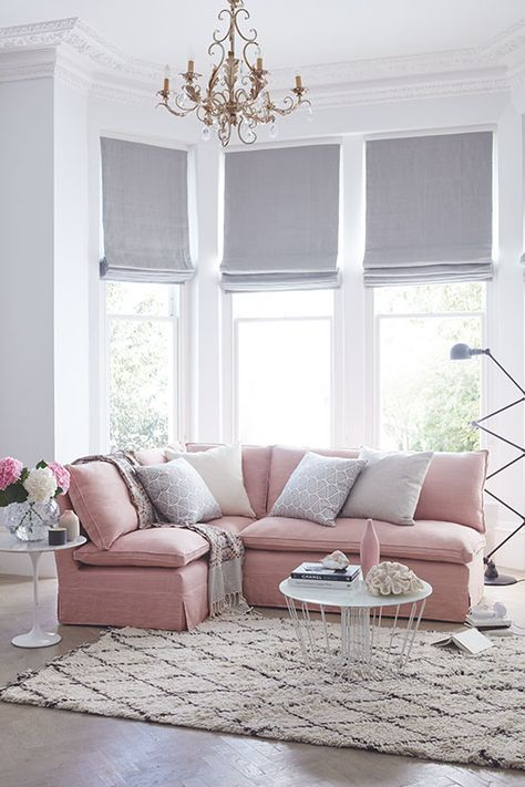 A guide to styling blush pink in your home. If you want to use blush pink in your sitting room, try a pretty pink corner sofa with neutral pillows.