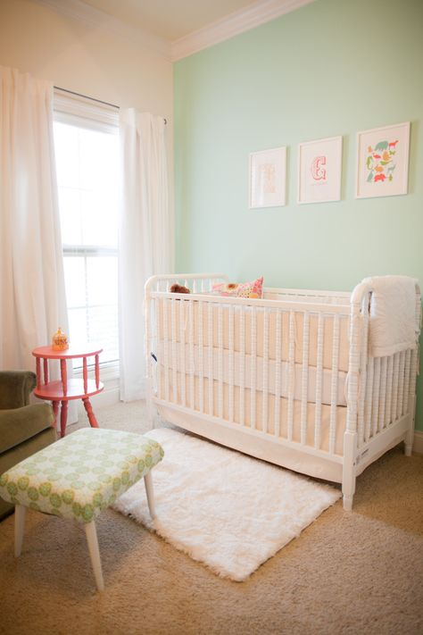 Mint green and white nursery with fluffy white rug, so gorgeous for a baby girl