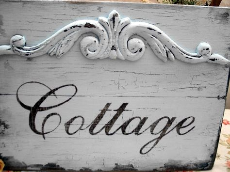 Great cottage sign.... you could actually make it yourself with board, paint, and ornamental wood or iron from Lowe's.  Great for a Staging Prop inside the house too
