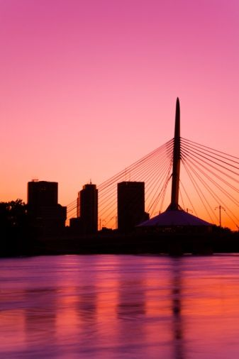 Winnipeg, Manitoba, Canada  My home :) I'd like to take credit for this beautiful shot of the St Boniface bridge restaurant over looking the red river and sunset. But I didn't take this pic.