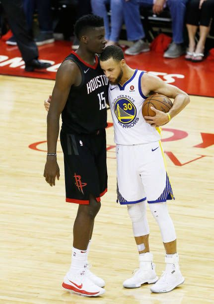 Stephen Curry Of The Golden State Warriors Embraces Clint Capela Of Basquet