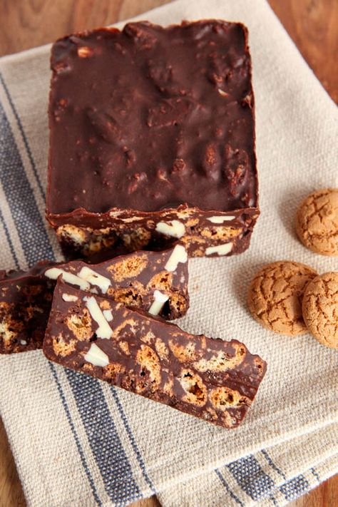 """""""No-Bake Dark Chocolate Amaretti Slices.""""  Simply melt dark chocolate with butter then stir in crumbled amaretti cookies and chopped white chocolate. Refrigerate in a loaf pan and once it is set you can slice and serve."""