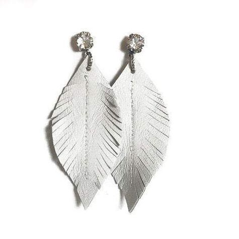 """Charmingly Boho! Fun Swarovski Crystal and Leather Feather Earrings called """"Donner"""". Looks great with jeans, Cowboy Hat, or LBD. Very light and comfortable. Coordinates with our Stacking Bracelets, Leather or Crystal necklaces and most any jewelry you already own. Layer, mix and match! Post closure ensures these earrings won't fall off! For when you are rocking your boho self!"""