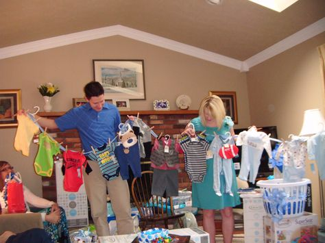 Baby shower gift idea ~ Use clothespins to attach baby clothes to ribbon and have future parents pull them out of a laundry basket ~ very cute idea!