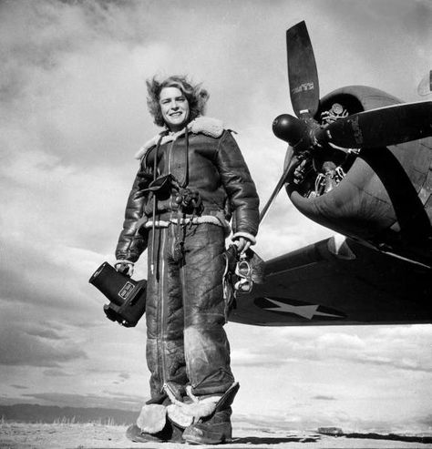 Margaret Bourke-White in sheepskin flight suit ready for aerial photography during WWII