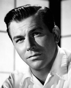 Howard Keel. Boy what a voice! He looks rather good with a mustache too