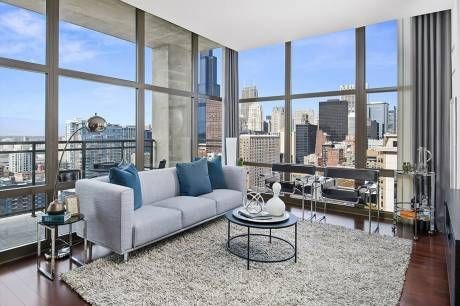 Interior Design Inspiration From This Modern South Loop Chicago Apartment With Floor To Ceiling Window Chicago Apartment Decor Chicago Apartment Apartment View