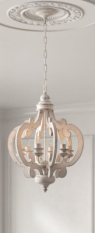 As much a work of art as a lighting fixture, this French country chic chandelier elevates the look of any room in your home, from the dining room to the entryway.#farmhouse #farmhousestyle #countrybedroom #farmhousemasterbedroom #decoratingideas #masterbedrooms #masterbedroomideas