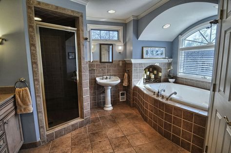 traditional master bathroom with bathtub, pedestal sink