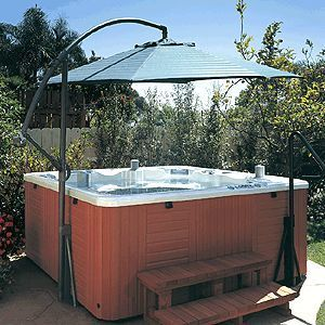 Spa Under The Umbrella Is Your Hot Tub A Little Hot If So You Can Get A Spa Umbrella And Have It Ma Hot Tub Backyard Hot Tub Pergola Hot